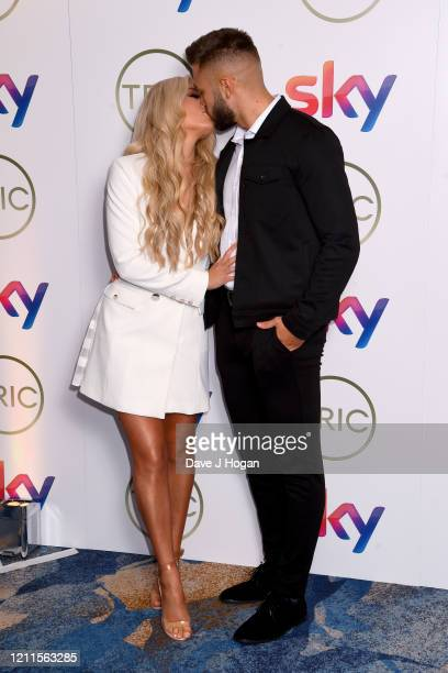 Paige Turley and Finley Tapp attend the TRIC Awards 2020 at The Grosvenor House Hotel on March 10 2020 in London England