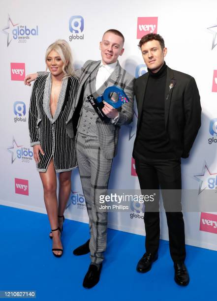 Paige Turley and Jimmy Hill with Aitch winner of the Rising Star Award at The Global Awards 2020 at Eventim Apollo Hammersmith on March 05 2020 in...