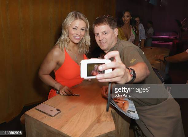 Paige Van Zant poses with a fan at the Sports Illustrated Swimsuit On Location at Ice Palace on May 10 2019 in Miami Florida