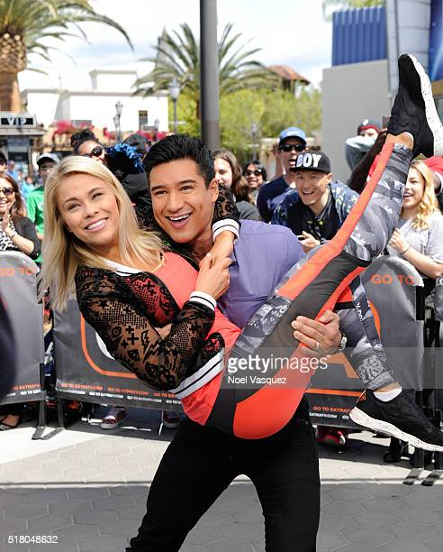 Paige VanZant and Mario Lopez pose together at 'Extra' at Universal Studios Hollywood on March 29 2016 in Universal City California