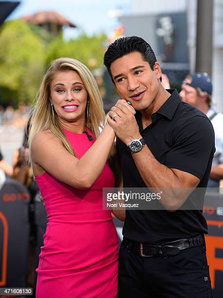 Paige VanZant and Mario Lopez visit Extra at Universal Studios Hollywood on April 29 2015 in Universal City California