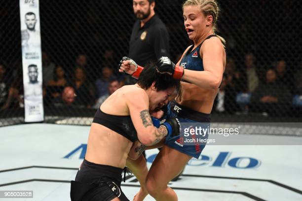 Paige VanZant knees JessicaRose Clark of Australia in their women's flyweight bout during the UFC Fight Night event inside the Scottrade Center on...