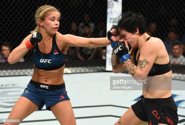 Paige VanZant punches JessicaRose Clark of Australia in their women's flyweight bout during the UFC Fight Night event inside the Scottrade Center on...