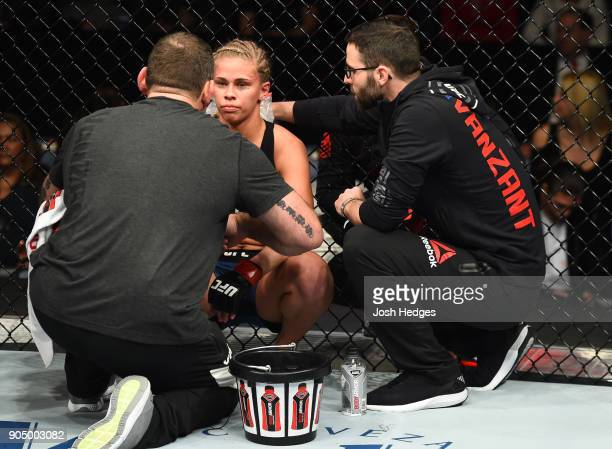 Paige VanZant receives advice from her corner inbetween rounds while facing JessicaRose Clark of Australia in their women's flyweight bout during the...