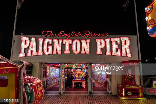 paignton pier sign and amusement arcade - torquay,_victoria stock pictures, royalty-free photos & images