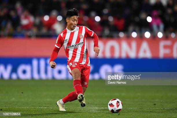 Paik Seungho of Girona FC runs with the ball during the Copa del Rey Round of 16 match between Girona FC and Atletico Madrid at Montilivi Stadium on...