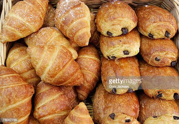 Pain Au Chocolate and croissants are stacked for sale on a stall during the Viva La France Show at Olympia on January 19 2006 in London England