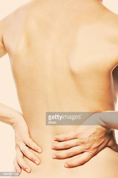 pain in a waist - beautiful bare bottoms stock photos and pictures