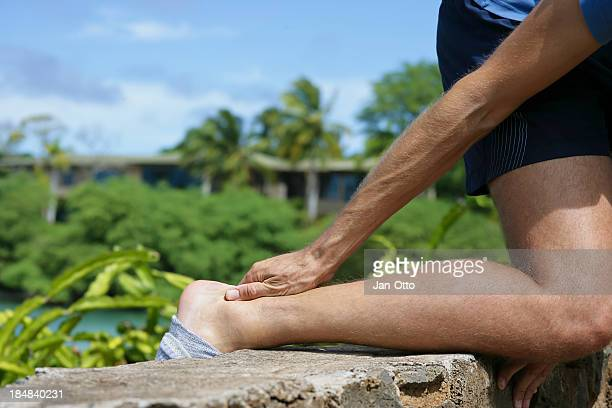 pain in achilles tendon - tendon stock photos and pictures