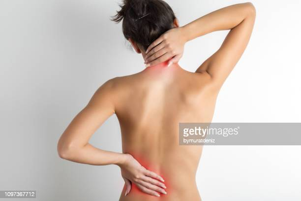 pain in back - torso stock pictures, royalty-free photos & images