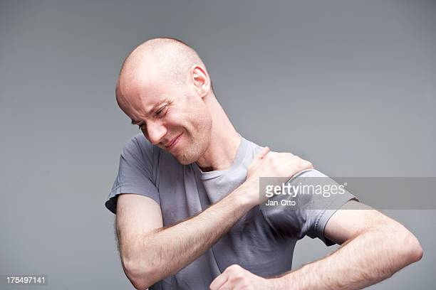 pain in shoulder - osteoarthritis stock photos and pictures