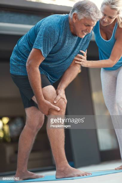 pain is only  temporary - knees together stock photos and pictures