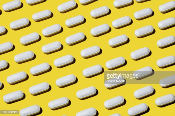 pain killers - pill stock pictures, royalty-free photos & images