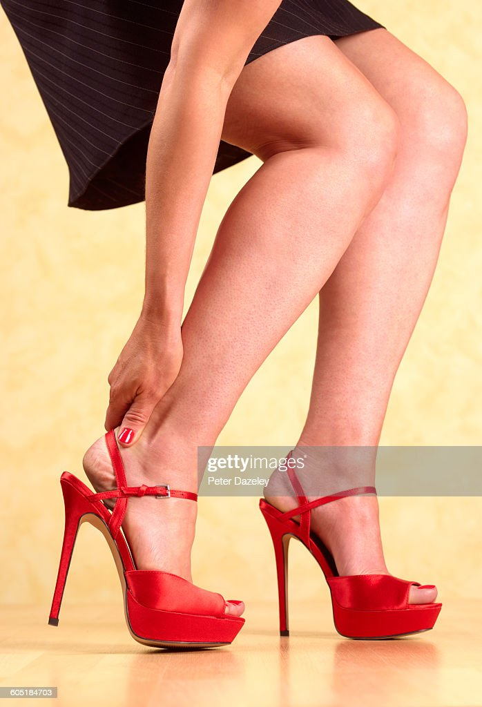 Pain of killer heels : Stock Photo