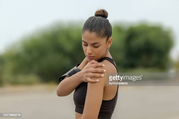 pain shoulder after workout - shoulder stock pictures, royalty-free photos & images