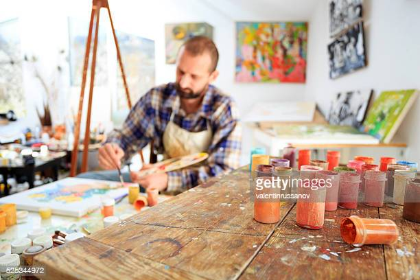 Painer drawing in his studio