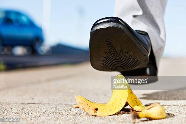 Painful slip coming as man's foot approaches banana peel