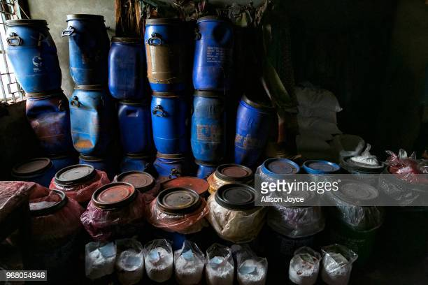 Paint and other chemicals are seen in a dying factory in Shyampur whose waste is dumped into the Buriganga river on June 4 2018 in Dhaka Bangladesh...