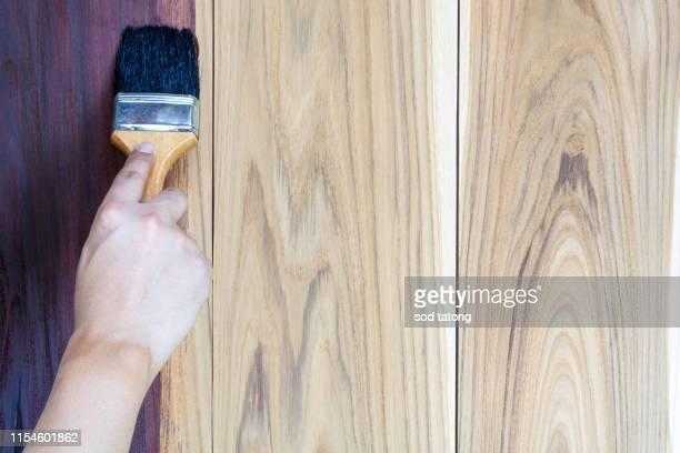paint brush, golden teak wood, thailand - garden decking stock pictures, royalty-free photos & images