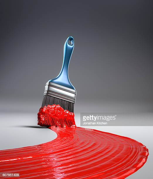 paint brush in red paint - paintbrush stock pictures, royalty-free photos & images