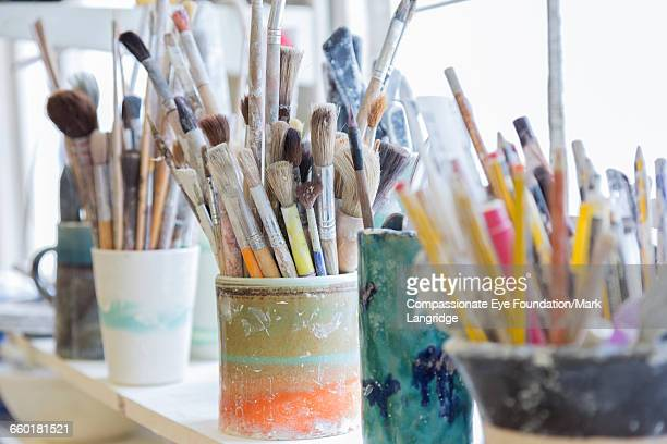Paint brushes in pottery studio