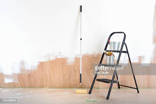 Paint brushes, paint roller, stepladder and paint