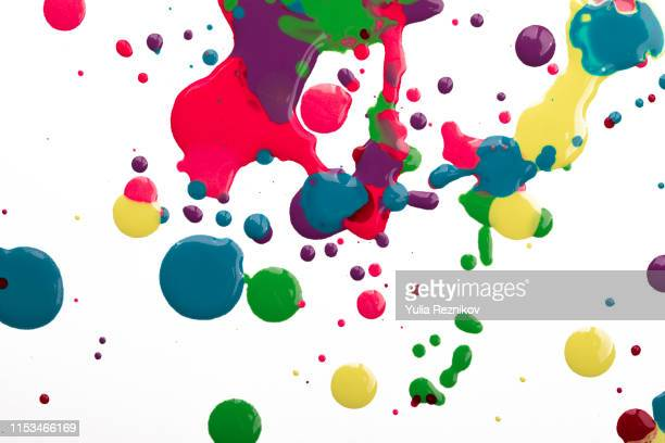 paint drops on white background - acrylmalerei stock-fotos und bilder