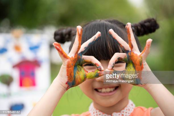 paint hands - 4 girls finger painting stock pictures, royalty-free photos & images