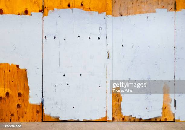 paint on wooden wall - weathered stock pictures, royalty-free photos & images