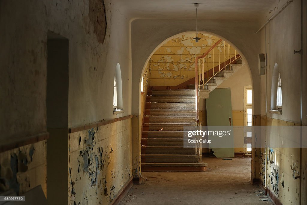 Paint peels from walls in a hallway and staircase in the officers' building at the former Soviet military base on January 26, 2017 in Wuensdorf, Germany. Wuensdorf, once called 'The Forbidden City,' was the biggest base for the Soviet armed forces in communist East Germany from 1945 until the last Soviet troops left in the early 1990s following the end of the Cold War and the reunification of Germany. While Soviet troops pulled out of eastern Europe after 1989, Russian troops have in recent years intervened in Ukraine. The NATO military alliance has strengthened its presence in the Baltic states in an effort to prevent similar Russian intervention there.