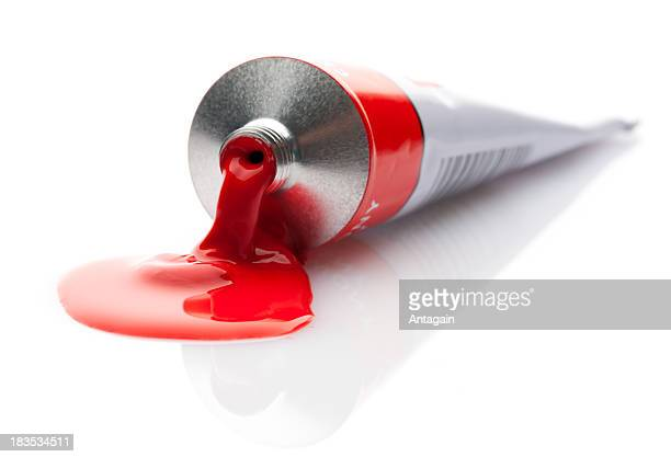 paint - red tube stock pictures, royalty-free photos & images