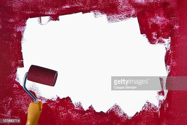 a paint roller and red paint - paint roller stock pictures, royalty-free photos & images