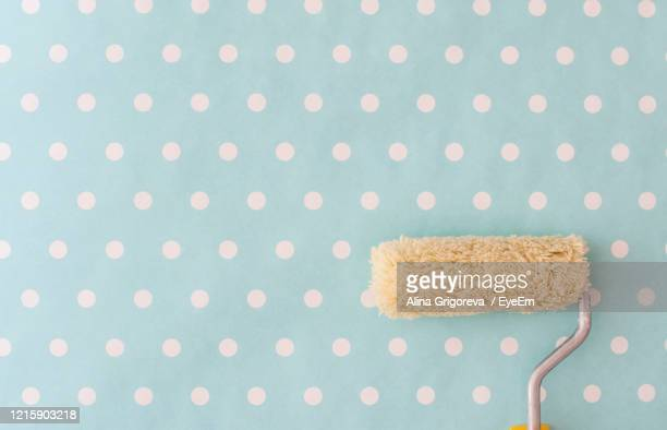 paint roller on wall - nursery bedroom stock pictures, royalty-free photos & images