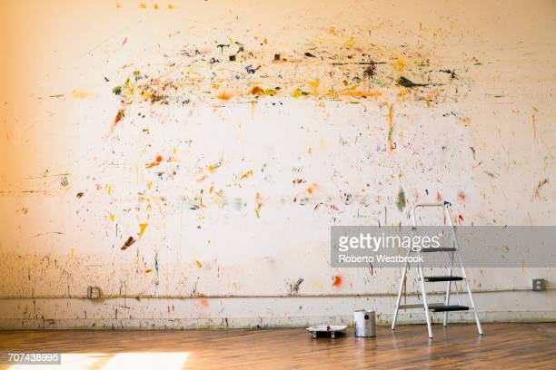paint splattered on wall near ladder - artist's canvas stock pictures, royalty-free photos & images
