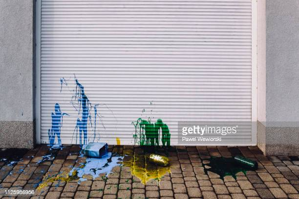 paint stains on garage door - vandalism stock pictures, royalty-free photos & images
