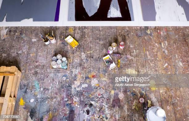 paint supplies on floor of art studio - künstleratelier stock-fotos und bilder