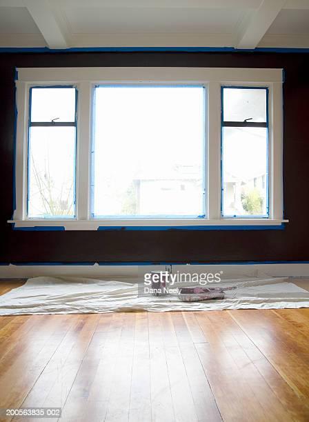 Paint tin and brush on floor