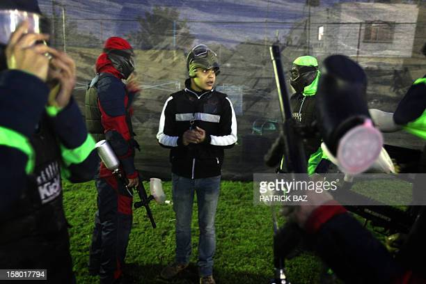A paintball instructor briefs Palestinian youths on the rules of the game in Gaza City on November 30 2012 'You're not here to make war but for fun'...