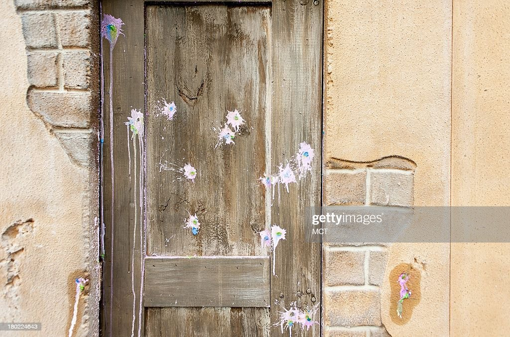 Paintball markers cover a door to a building in the faux Middle Eastern village that is used for training purposed at the Diplomatic Security Training ... & Paintball markers cover a door to a building in the faux Middle ...