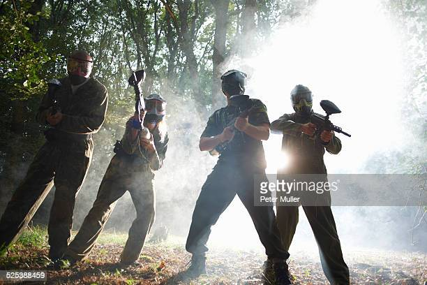 Paintball players in action