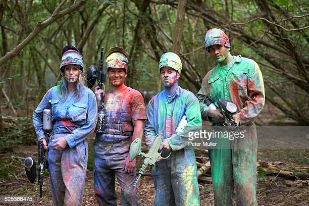 paintball players in paintball wear marked with paint - paintball foto e immagini stock