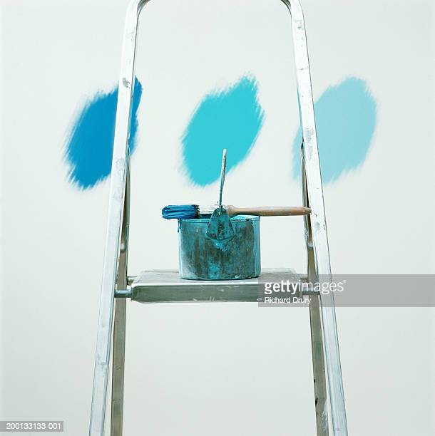 paintbrush and can on ladder in front of three shades of blue on wall - color swatch stock pictures, royalty-free photos & images