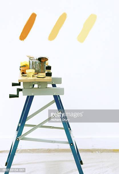 paintbrush and pots on workbench, three shades of brown on wall - richard drury stock pictures, royalty-free photos & images