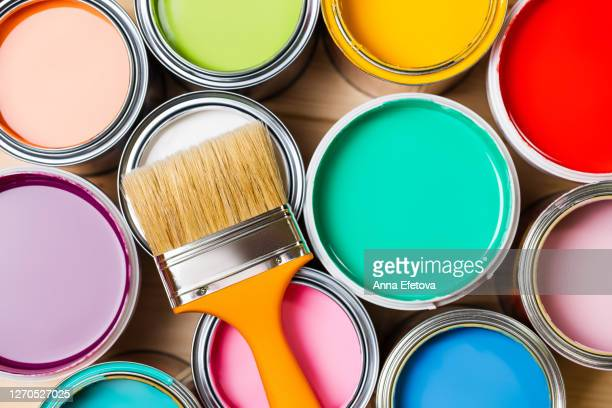 paintbrush on open tins with pigments - improvement stock pictures, royalty-free photos & images