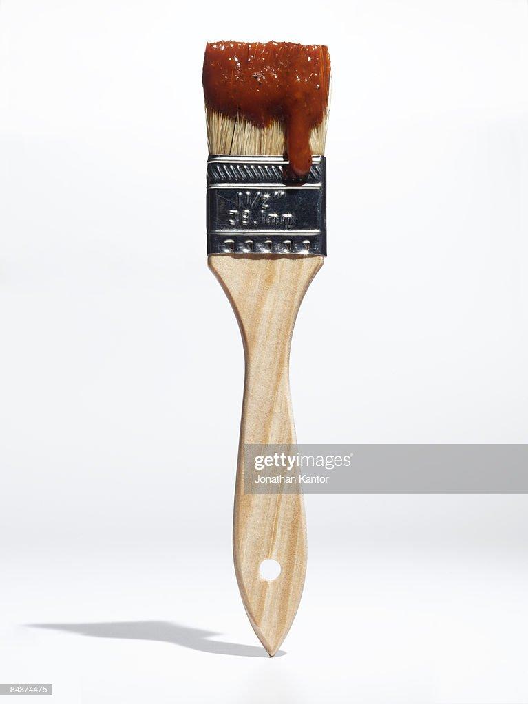Paintbrush with BBQ sauce : Stock Photo