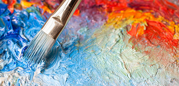 paintbrush with oil paint on a classical palette - visual arts stock pictures, royalty-free photos & images