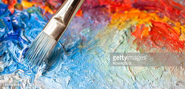 paintbrush with oil paint on a classical palette - paintbrush stock pictures, royalty-free photos & images