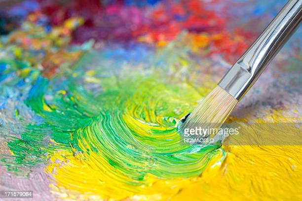 paintbrush with oil paint on a classical palette - mixing stock pictures, royalty-free photos & images