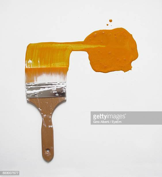 Paintbrush With Orange Paint