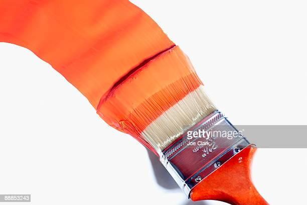 Paintbrush with orange paint